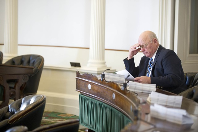 Sen. Norm McAllister prepares for the 2015 legislative session Tuesday morning in the Senate chamber. - JEB WALLACE-BRODEUR