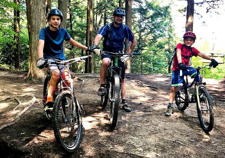 Bousquet and his boys mountain biking - BROOKE BOUSQUET