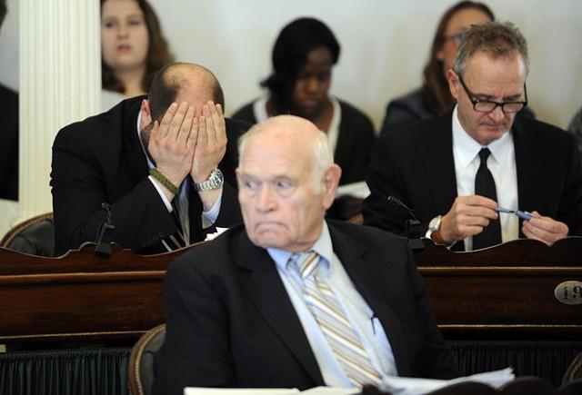 Sen. Dustin Degree, his head in his hands, Sen. Dick Sears and Sen. Chris Bray listen to the debate over suspending Sen. Norm McAllister. - JEB WALLACE-BRODEUR