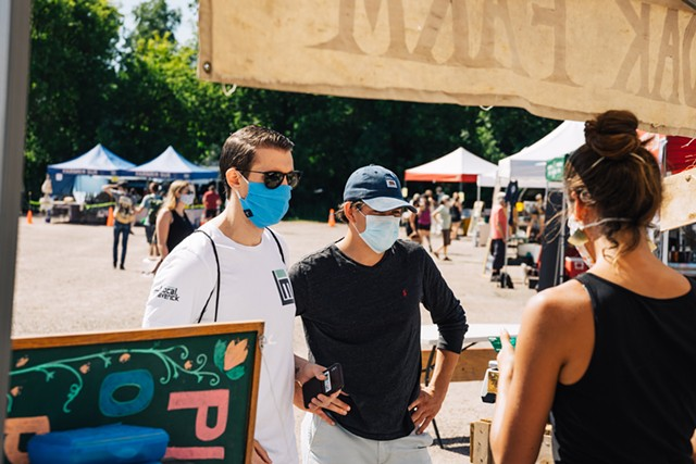 Local Maverick founder Ryan Nakhleh (left) and team member Alex Farrell shopping at the Hudak Farm stand at the Burlington Farmers Market - CURRAN MCKEE, COURTESY OF RYAN NAKHLEH