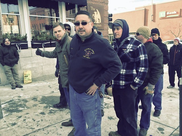 Michael Hart and a group of Donald Trump supporters from the Plattsburgh, N.Y., area wait in line on Main Street. - MARK DAVIS