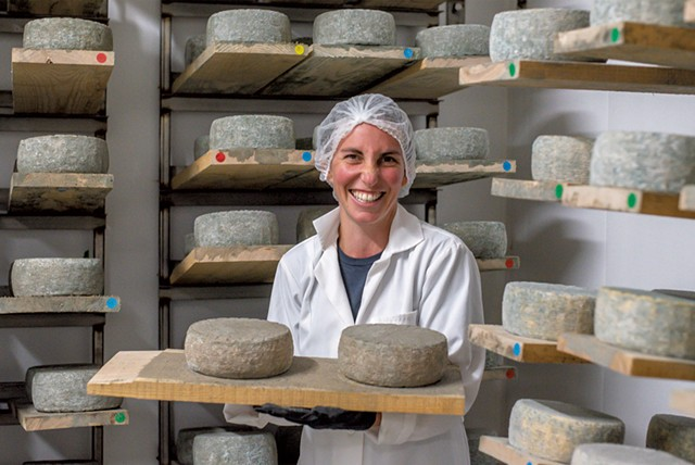 Melanie Webb with some of the raw-milk cheese she makes at Stony Pond Farm - GLENN RUSSELL