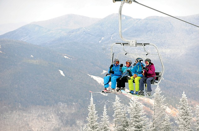 Skiers on a lift at Stowe Mountain Resort, pre-COVID - FILE: JEB WALLACE-BRODEUR ©️ SEVEN DAYS