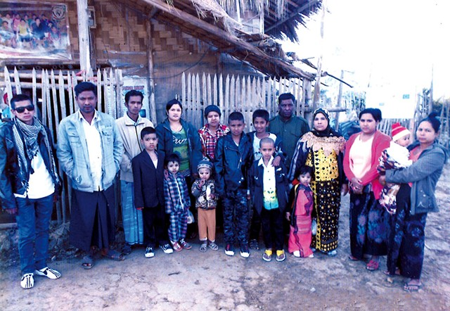 Me Me (in yellow and black) and her family in a refugee camp in Thailand in 2014 - COURTESY OF ME ME'S FAMILY