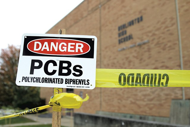 Signs warning about PCBs at Burlington High School - COURTNEY LAMDIN ©️ SEVEN DAYS