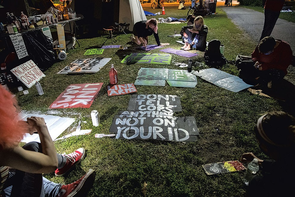 Protesters making signs - JAMES BUCK
