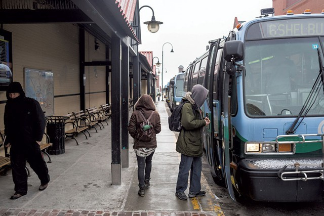 CCTA riders board buses on Cherry Street in Burlington. - OLIVER PARINI