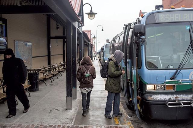 CCTA riders board buses on Cherry Street in Burlington. - OLIVER PARINI