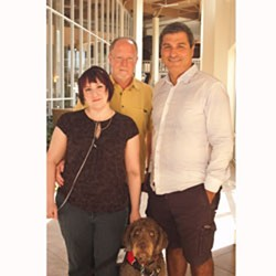 Dr. Paolo Macchiarini (right) with Rachel and Steven Phillips of Burlington in July 2011. - FILE: KEN PICARD