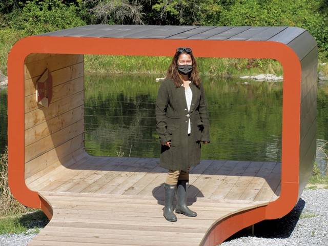 "Lisa Mitchell in front of ""Oona's Bridge"" by Silver Maple Construction - AMY LILLY"