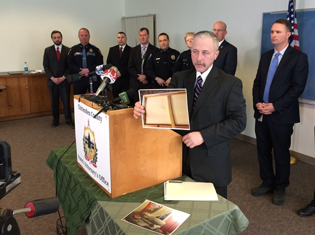 Vermont State Police Captain J.P. Sinclair displaying evidence at a press conference - MARK DAVIS