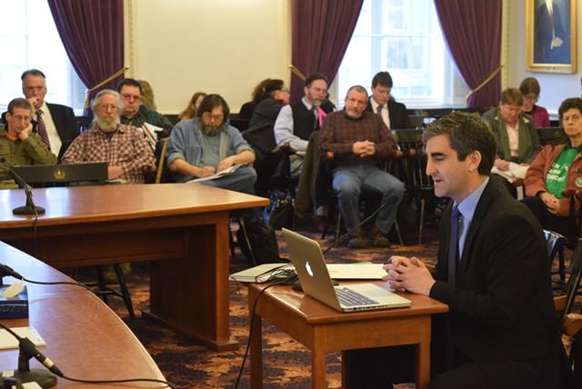 Burlington Mayor Miro Weinberger speaks at the Statehouse, as gun-rights activists look on. - TERRI HALLENBECK
