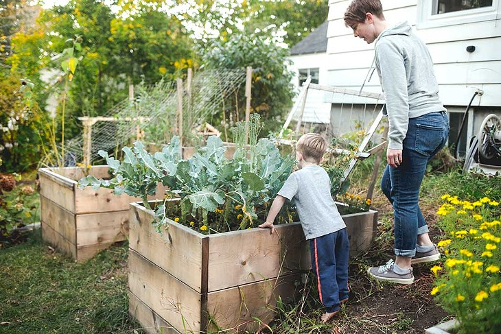 Maresa Nielson tending the garden with one of her foster sons - SARAH PRIESTAP
