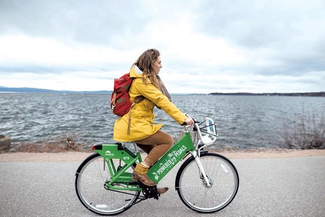 A cyclist on a Greenride bike in Burlington - COURTESY OF GOTCHA