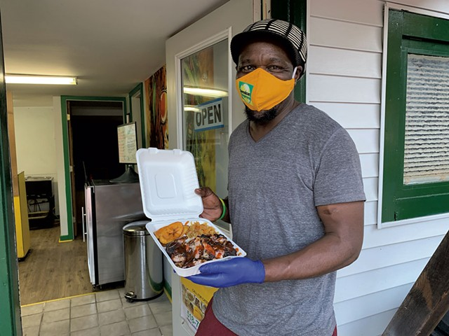 """Bilon """"Richie"""" Bailey with takeout from Jamaican Supreme - MELISSA PASANEN"""