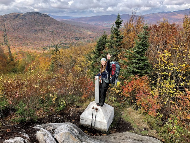 Jocelyn Hebert at the end of the Long Trail on the Canada border - COURTESY OF JOCELYN HEBERT