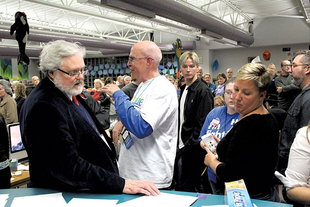 Urbandale caucus chair Jerry Tormey and vice chair Suki Sanford Monday at the Rolling Green Elementary School - PAUL HEINTZ