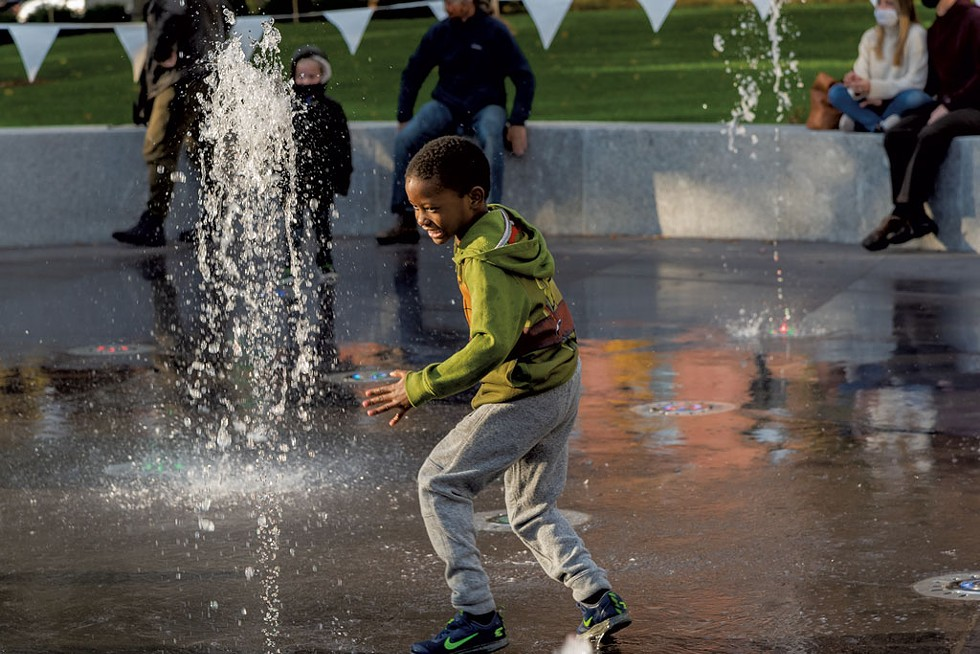 A child plays in the the new fountain at Burlington's City Hall Park - RENEE GREENLEE | COURTESY OF BURLINGTON CITY ARTS