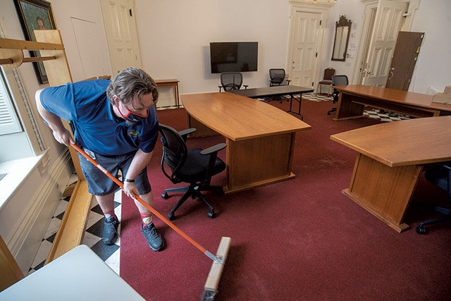 Custodian Mike Metcalf readying the coatroom at the Statehouse - JEB WALLACE-BRODEUR