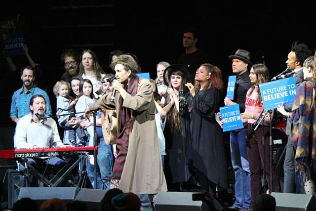 Alex Ebert leads musicians at a concert Monday for Sen. Bernie Sanders - PAUL HEINTZ