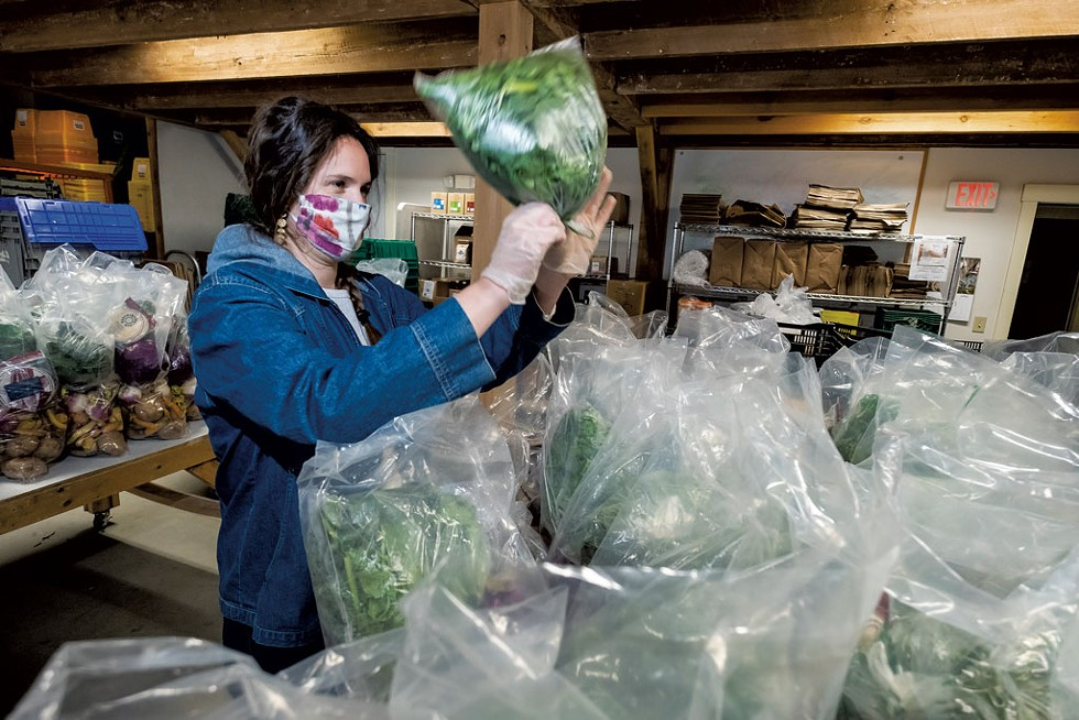 Preparing food for distribution - COURTESY OF THE VERMONT FOODBANK