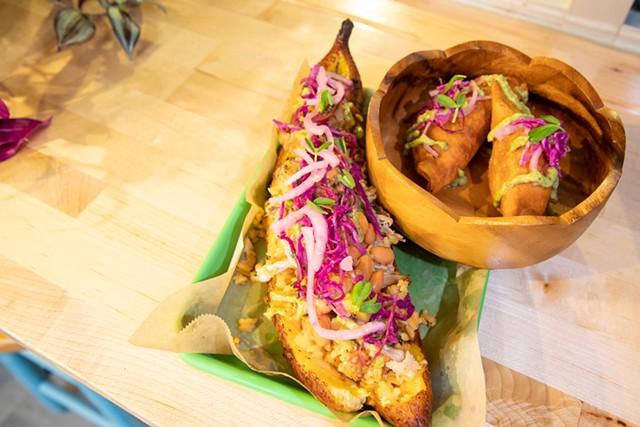 A stuffed canoa and empanadas at Café Mamajuana - JAMES BUCK