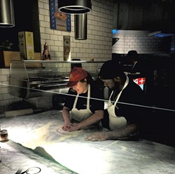 The author making pizza with Bruce Ringgold - COURTESY OF PIZZERIA VERITÀ