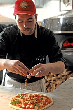 Griffeon Chuba making a pizza. - MATTEHW THORSEN