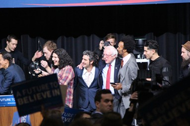 """Sanders and supporters sing """"This Land Is Your Land"""" at a concert in Henderson, Nevada. - PAUL HEINTZ"""