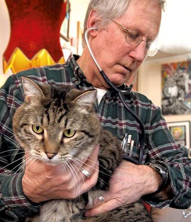 Dr. Sturgis listening to Buddy's heart - MATTHEW THORSEN