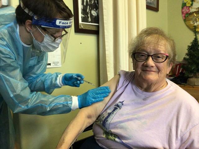 Helen Porter Rehabilitation and Nursing resident Elsie Johnson gets vaccinated on Monday. - PHOTO COURTESY OF PORTER MEDICAL CENTER