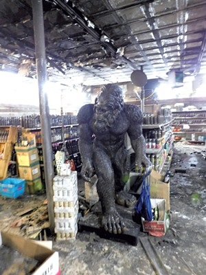 Harriet the Sasquatch amid the fire damage - COURTESY OF JOHN DUBIE