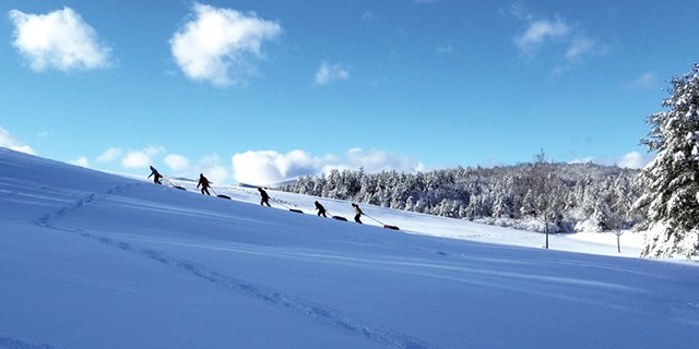 Tubers climbing the sledding hill - COURTESY OF UMIAK OUTDOOR OUTFITTERS