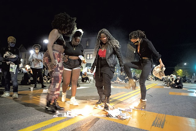 Protest leaders stomping out the flames after igniting a small pile of Seven Days newspapers - FILE: JAMES BUCK