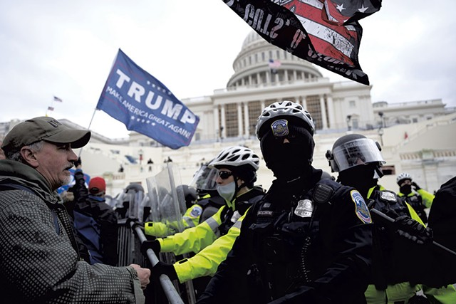 Trump supporters and police officers at Capitol Hill on January 6 - © DREAMSTIME.COM/JULIAN LESHAY