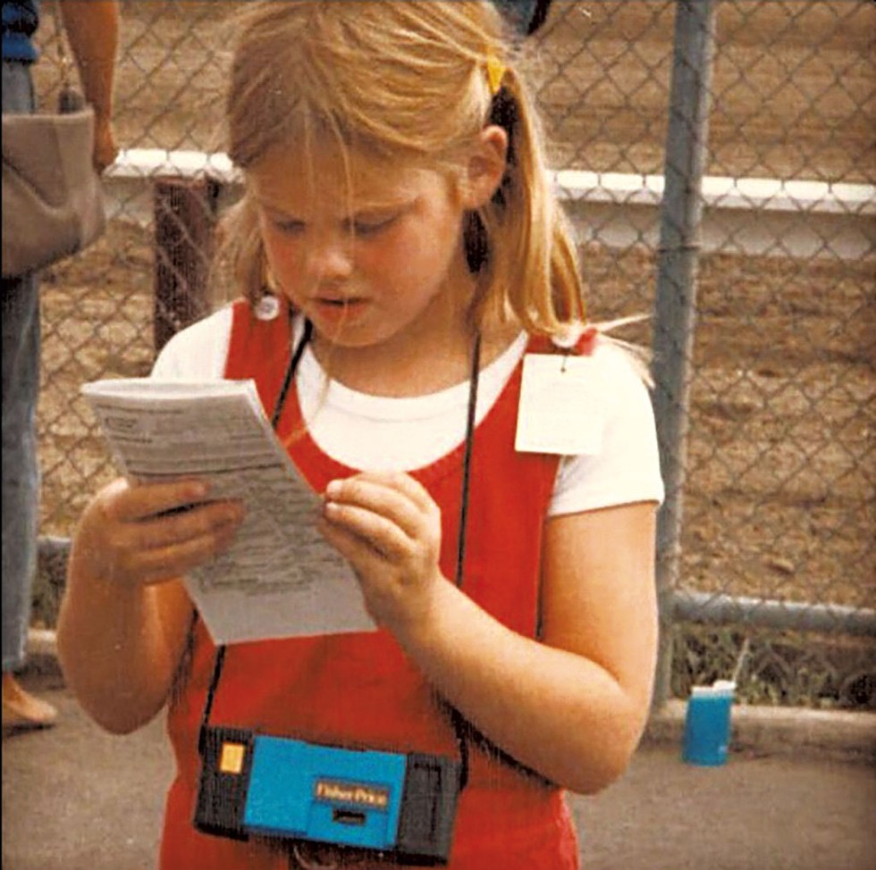 "At the horse races in Saratoga, N.Y., ""reading"" the betting sheet - COURTESY"