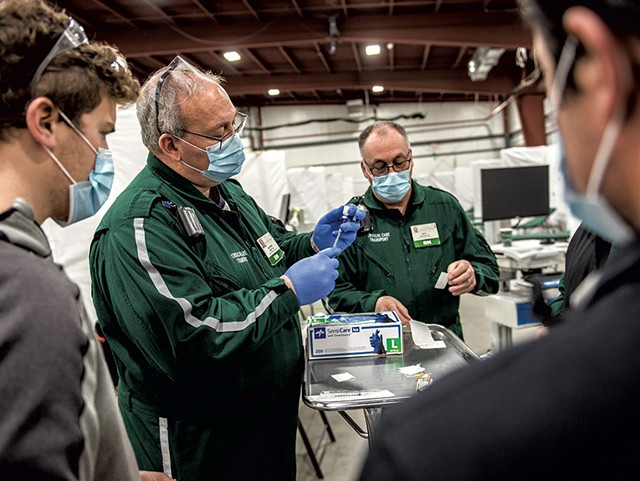 Preparing doses of the Pfizer COVID-19 vaccine at a University of Vermont Health Network vaccination clinic at the Champlain Valley Exposition - COURTESY OF UVM MEDICAL CENTER/RYAN MERCER