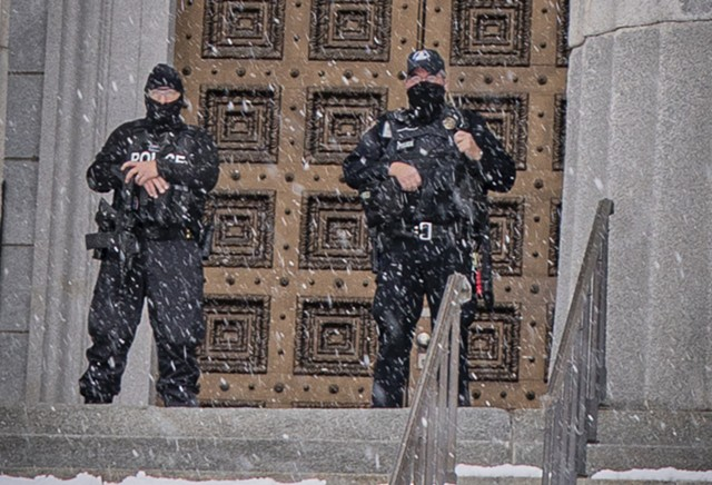 Officers outside the Statehouse Sunday - TERRY J. ALLEN