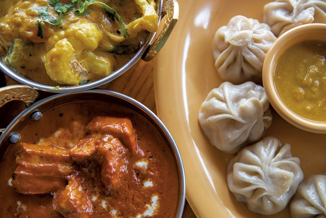 Vegetable korma, chicken momos and chicken tikka masala at Red Panda in Burlington - FILE: JAMES BUCK