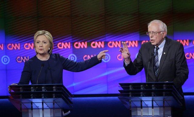 Hillary Clinton and Sen. Bernie Sanders debate Sunday night in Flint, Michigan. - AP PHOTO/CARLOS OSORIO