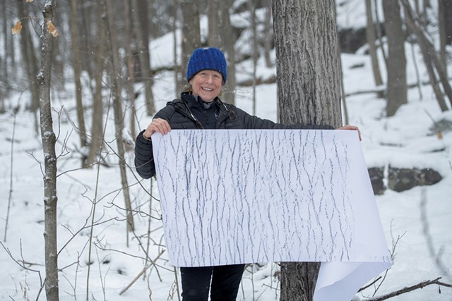 Elizabeth Billings holding a tree rubbing - DARIA BISHOP