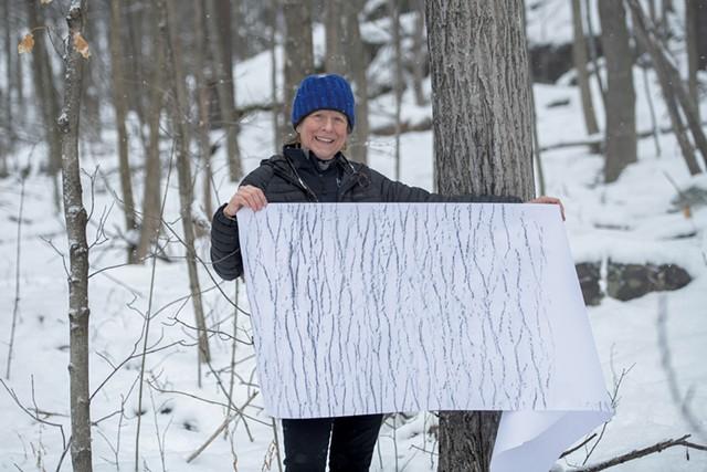 Elizabeth Billings holding a tree rubbing - DARIA BISHOP
