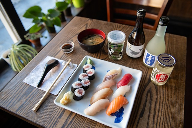 A sushi assortment with miso soup and a variety of drinks at Bento - DARIA BISHOP