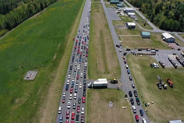 Cars line up to get food during a Farmers to Families Food Box drop last year - JAMES BUCK ©️ SEVEN DAYS