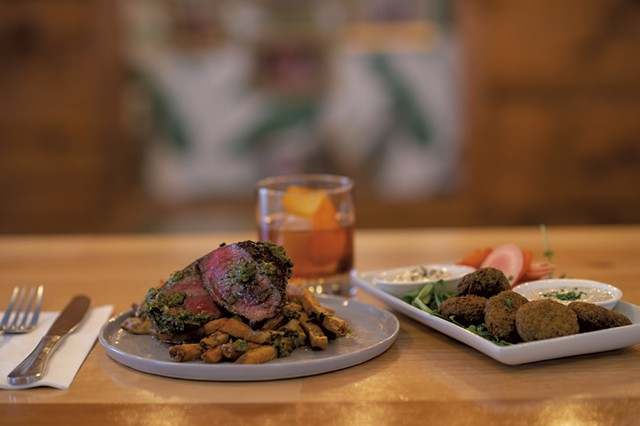 Steak and French fries, an old fashioned cocktail, and falafel from Peg & Ter's - DARIA BISHOP
