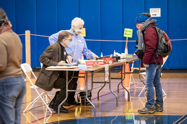 Voters checking in at Edmunds Middle School - LUKE AWTRY
