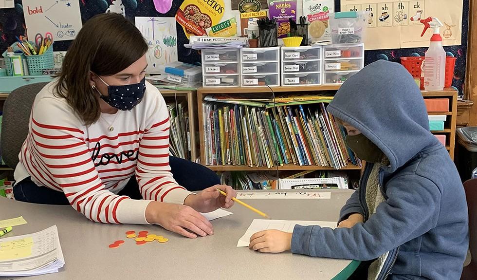 Kindergarten teacher Rachel Whalen helping a student at Union Elementary School in Montpelier - COURTESY OF RACHEL WHALEN