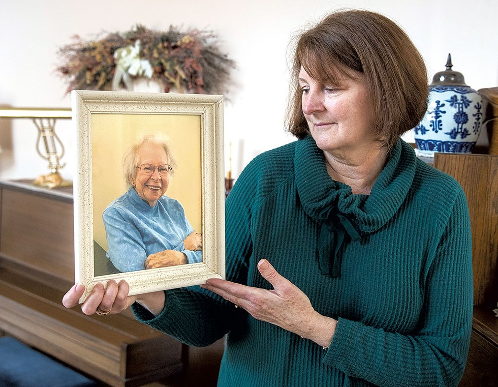 Pam Reith holding a photo of her mother, Beverly Peters - JAMES BUCK