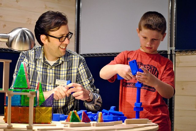 Marcos Stafne engaging in hands-on science with young patron - MONTSHIRE MUSEUM OF SCIENCE