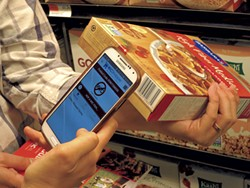 Scanning a cereal box with the WICShopper app - MATTHEW THORSEN